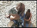 Paare ficken am Strand und werden gefilmt